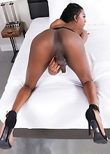 Black tgirl Mya Badd has a sexy bubble butt, big boobs and a big uncut cock! Enjoy her creamy cumshot!