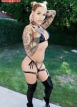 Tattooed tgirl Nadia Love in a smoking hot solo scene!