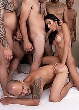 See Alice Marques gangbanged by 11 men and all of them cumming in her mouth and ass!