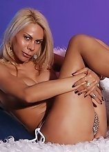 Nicole Gaucha gives her massive love stick a good rubbing on a fluffy sofa