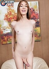 Redhead tgirl Crystal Thayer has a sexy slim body, long legs and perfect booty! Watch her stroking her cock until she reaches orgasm!