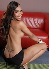 Beautiful ebony transsexual Jade posing in lace and heels